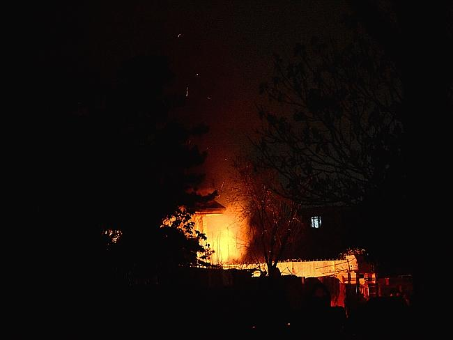 Dramatic scenes ... smoke and flames light up the night during the attack.