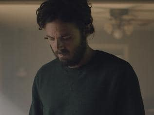 "This image released by A24 shows Casey Affleck in a scene from the film, ""A Ghost Story."" (Bret Curry/A24 via AP)"