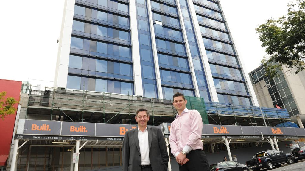 Pro-Invest managing director Phil Kasselis with Holiday Inn Express Brisbane Central manager Michael Foster. The hotel will open early next year.