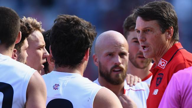 Demons coach Paul Roos addressing his players during loss to Essendon. Picture: Getty