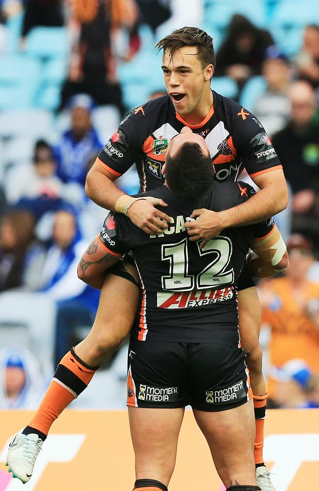 Luke Brooks celebrates a try.
