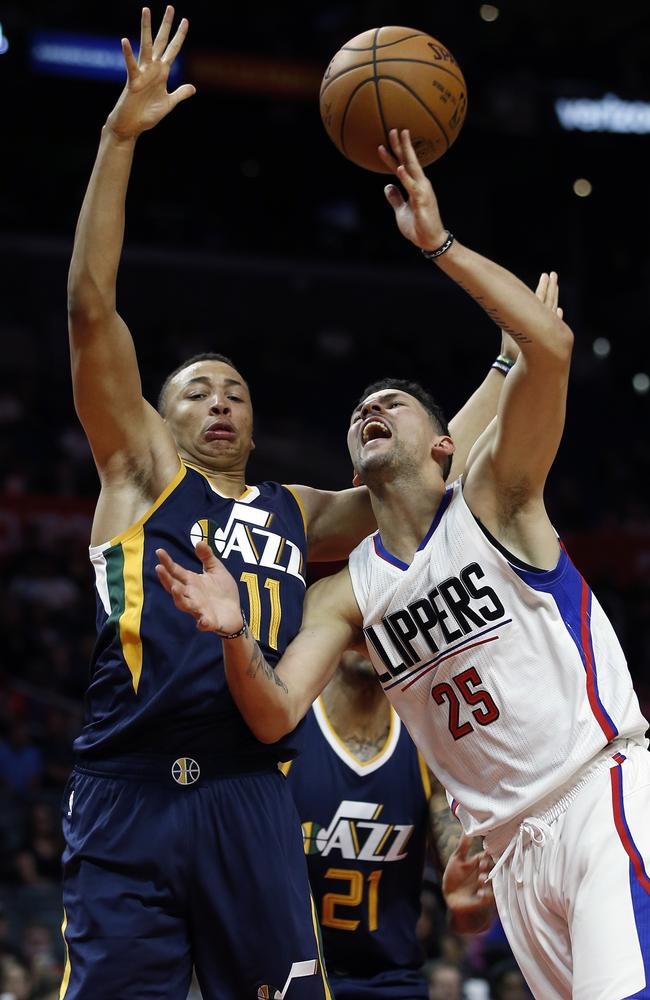 Clippers guard Austin Rivers (25) has the ball knocked away by Dante Exum.