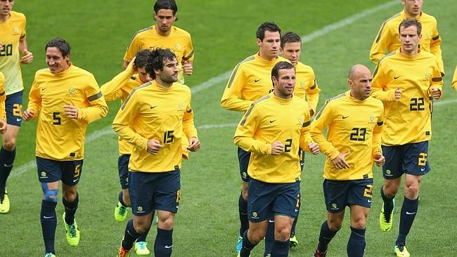 The Socceroos team warm-up.