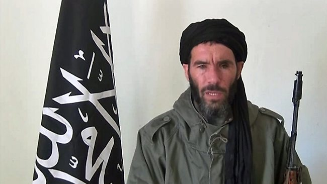 """An undated grab from a video obtained by ANI Mauritanian news agency reportedly shows former Al-Qaeda in the Islamic Maghreb (AQIM) emir Mokhtar Belmokhtar speaking at an undisclosed location. Islamists are holding 41 foreigners hostage, including seven Americans, after an attack on a gas field in eastern Algeria, a spokesman for the militants told two Mauritanian news websites. AFP PHOTO / HO / ANI ==RESTRICTED TO EDITORIAL USE - MANDATORY CREDIT """"AFP PHOTO / HO / ANI"""" - NO MARKETING NO ADVERTISING CAMPAIGNS - DISTRIBUTED AS A SERVICE TO CLIENTS =="""