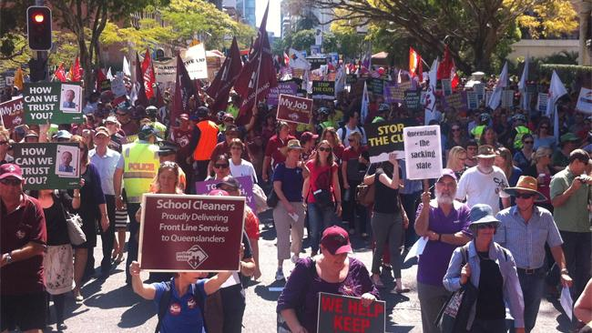Public servants and blue-collar workers march through Brisbane's CBD to protest against sweeping job cuts. Picture: Phil Norrish