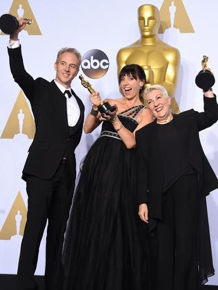 The Best Make-Up and Hairstyling team (from left) Martin, Elka Wardega and Vanderwalt celebrate their win. Picture: AFP / Frederic J. Brown