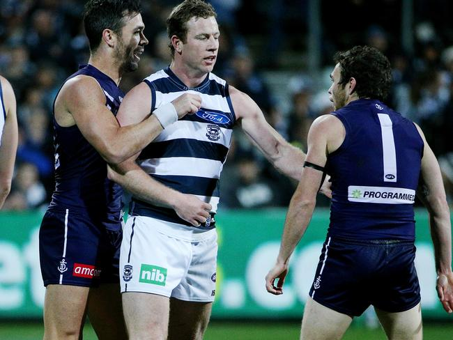 Steve Johnson tangles with Ryan Crowley and Hayden Ballantyne. Picture: Colleen Petch.