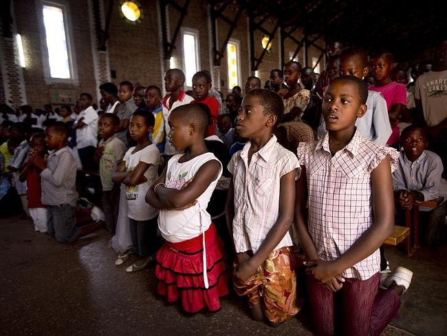 Two decades later ... Rwandan children listen and pray during a Sunday morning service at