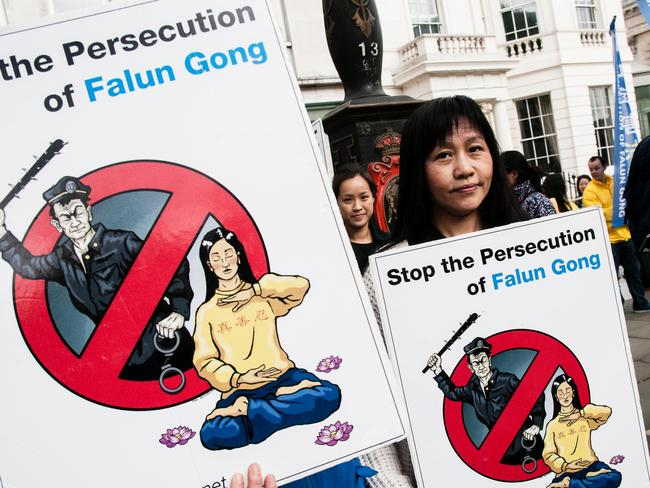 Falun Gong practitioners hold banners during a protest against the Chinese government in London last year. Picture: Noemi Gago/Alamy Live News
