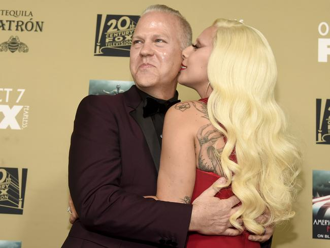 Lady Gaga with executive producer/director/writer Ryan Murphy, who she says she's grateful to for giving her a sense of self-belief. Picture: Chris Pizzello/Invision/AP
