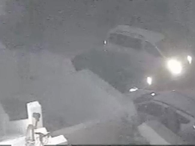 6:39am: At this stage al-Libi has been bundled into the van. You can see the second vehicle blocking al-Libi's car. Picture: CCTV