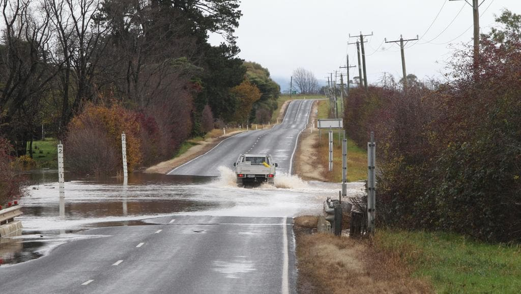 A flooded road at Carrick near Launceston last year. The state's northern river basins have been put on flood watch this morning.