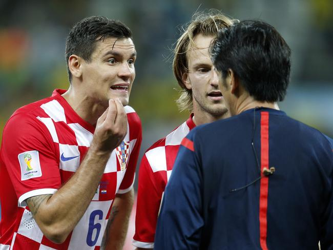 Croatia's Dejan Lovren, left, questions how on earth the annual Japanese Antarctic whale cull contributes to scientific research. Or perhaps he's really questioning the dodgy penalty in the opening game of the Brazil 2014 FIFA World Cup. Picture: AP/Frank Augstein