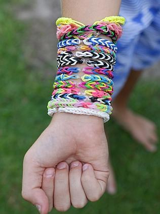 Some of the colourful designs that can be created with Rainbow Looms. Pic: Jono Searle