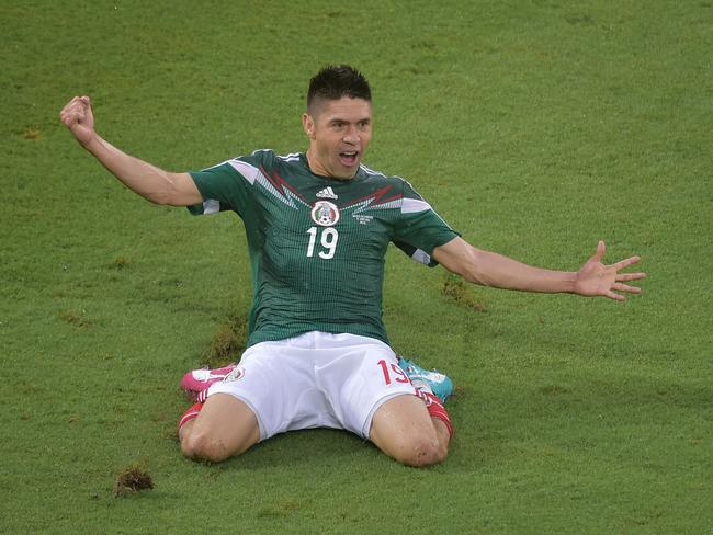 Mexico forward Oribe Peralta celebrates after scoring the only goal during the Group A World Cup match between Mexico and Cameroon.