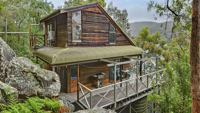 For $350,000 this wooden cabin with bush and water views at Bar Point could be all yours.
