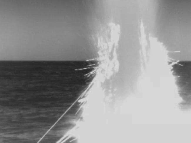 In this image from video provided by the U.S. Navy, a US fast-attack submarine launches a tomahawk missile from the Mediterranean Sea as part of a US-led military operation in retaliation for Syria using chemical weapons.