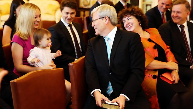 Kevin Rudd's granddaughter, Josephine, steals the limelight at Mr Rudd's swearing-in at Government House. Looking on are Jessica Rudd (cradling Josephine), Terese Rein and deputy PM Anthony Albanese. Picture: Craig Greenhill