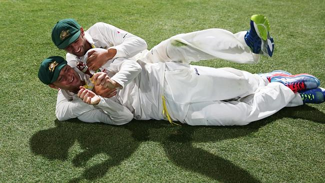Michael Clarke and Nathan Lyon on the SCG turf late on Sunday night. Picture: Phil Hillyard.