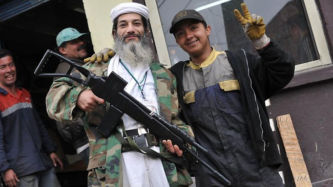Colombian Hasmet Hichster Londono, an admirer of al-Qaeda leader Osama bin Laden, has been personifying him for seven years, walks around the neigbourhood of Santa Fe in Bogota, Colombia. Picture: AFP