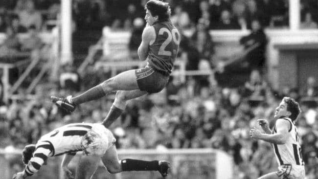 Up there, Rossy! Ross Lyon is known for his defensive tactics as a coach, but he had some flair on the field and was super tough. We're slotting him in at CHF because a) there's a lack of genuine forwards in the coaching ranks and b) we found this pic. So there.