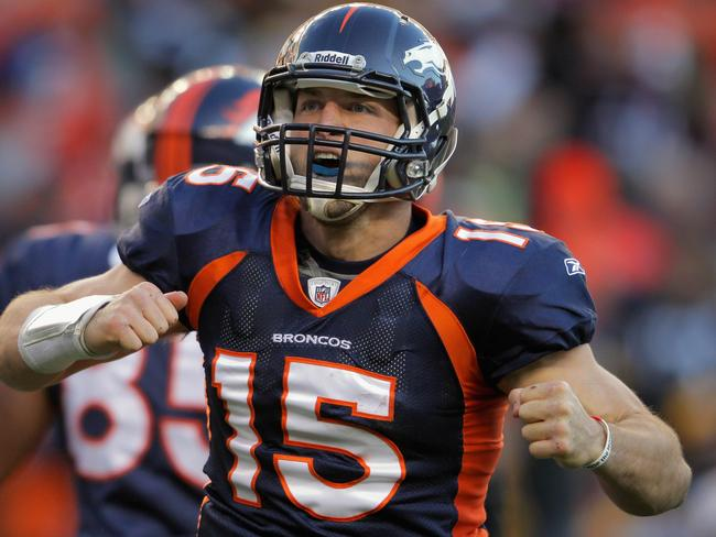Tim Tebow celebrates his rushing touchdown playing for Denver Broncos in 2012.