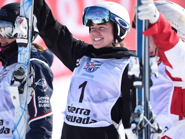 Britteny Cox, centre, after winning the gold medal at the FIS Freestyle Ski and Snowboard world championships.