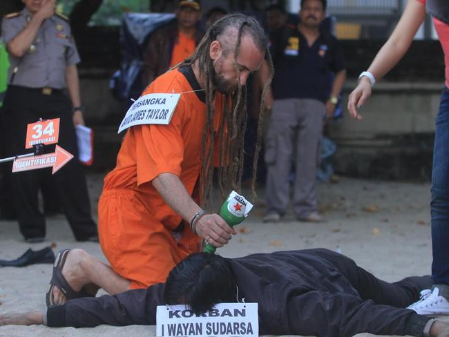 Sara Connor and David Taylor take part in a police re-enactment on Kuta beach on August 31 Picture: Zul Eduardo