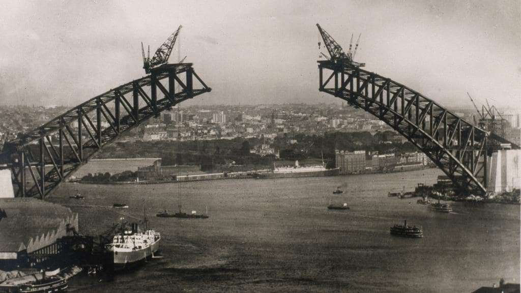 The harbour bridge under construction in 1930 picture state library