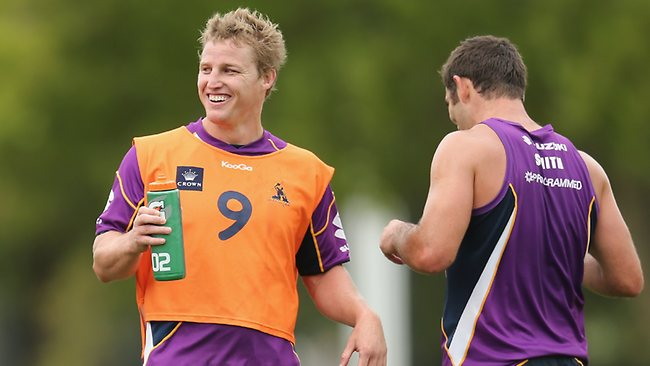 Brett Finch (L) and Cameron Smith of the Storm look on during a Melbourne Storm NRL training session at Gosch's Paddock.