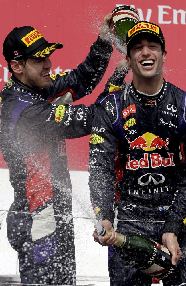 Ricciardo and Vettel celebrate on the podium.