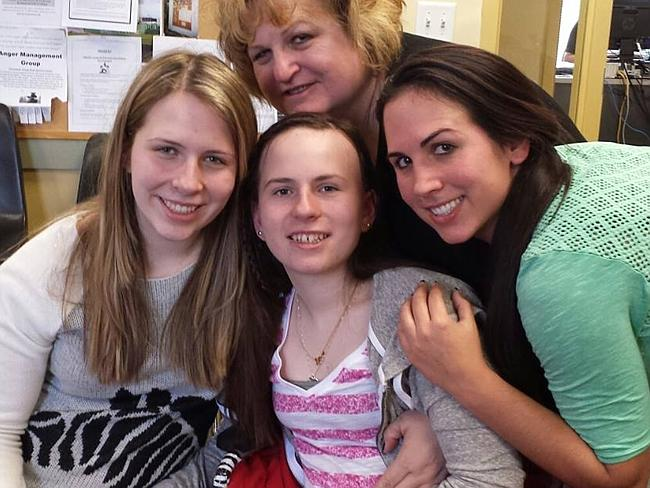 Justina with her mother and two of her sisters