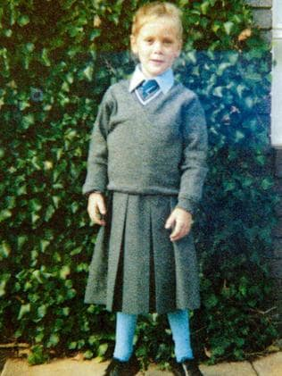 Cute little Sam Squiers in her winter uniform in primary school. Totally impractical for playing sport!