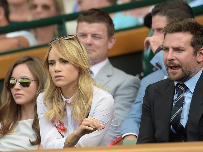 US actor Bradley Cooper and his girlfriend British model Suki Waterhouse sit in the Royal box on Centre Court.