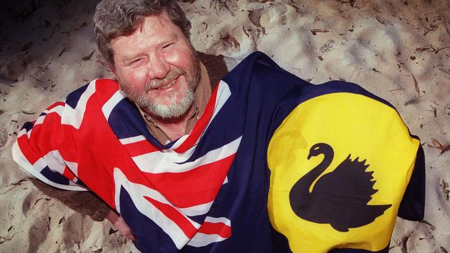 Stewart van Raalte, a flag maker, with the Western Australian state flag Picture: Jackson Flindell