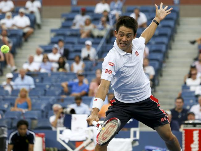 Kei Nishikori held on to defeat Stan Wawrinka.