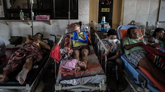 Typhoon victims are treated in the lobby of the Divine Word hospital. Picture: Philippe Lopez