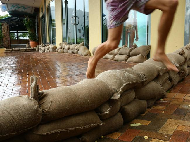 Sandbagging in the main street of Airlie Beach in preparation for cyclone Debbie. Picture: Liam Kidston.