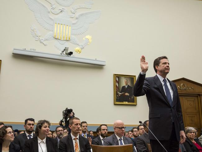 "FBI Director James Comey is sworn in during a House Judiciary Committee hearing titled ""The Encryption Tightrope: Balancing Americans' Security and Privacy,"" on Capitol Hill."