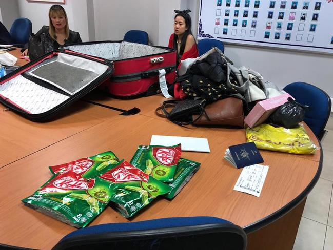 Ve Thi Tran (back, left) with her suitcase and belongings including Kit-Kats in the foreground. Picture: Khmer Immigration Department