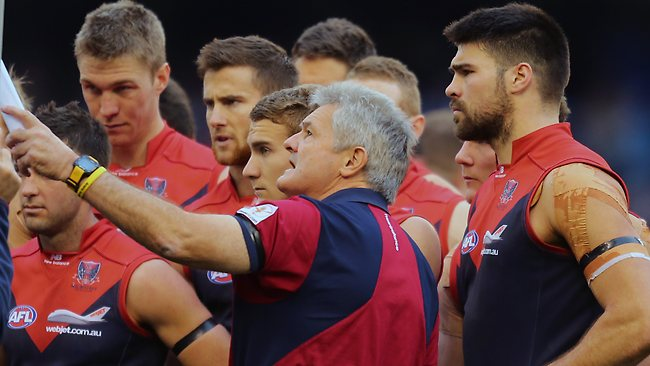 Demons coach Neil Craig speaks to his team at quarter-time.