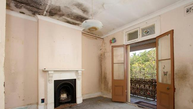 More work to do in one of the upstairs bedrooms of the old terrace house in Sydney's Redfern. Picture: realestate.com.au.