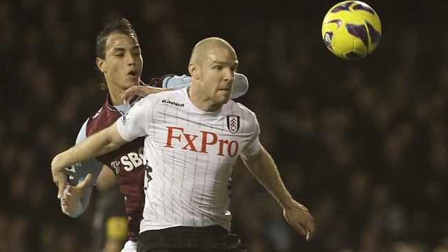 Fulham's Philippe Senderos, right, competes with West Ham United's Marouane Chamakh during their English Premier League soccer match at Craven Cottage. Picture: Sang Tan