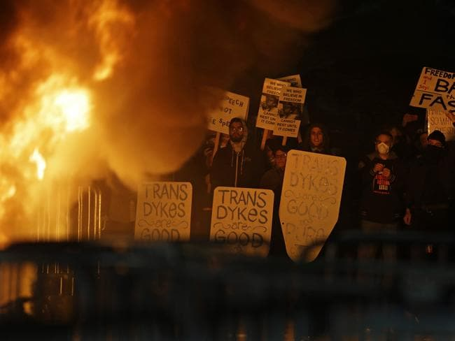 Protesters watch a fire on Sproul Plaza during a rally against the scheduled speaking appearance by Breitbart News editor Milo Yiannopoulos on the University of California at Berkeley campus. Picture: AP