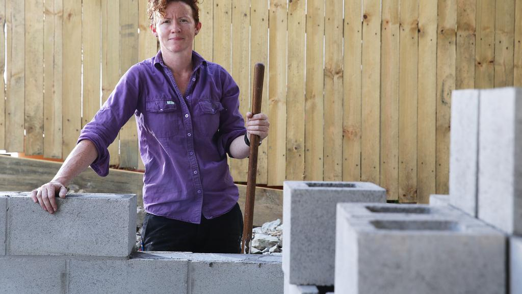 Laura Madden, from Eve Renovations, has worked in the building industry for the past 15 years and said the dangers of silica was part of her early training. Picture: AAP/Claudia Baxter