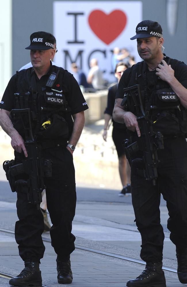 Armed police patrol the streets in central Manchester. Picture: AP / Rui Vieira