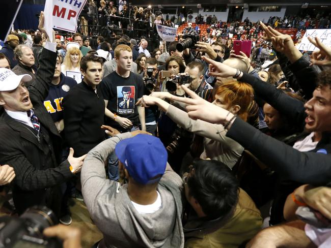 Anger ... Supporters of Republican presidential candidate Donald Trump, left, face off with protesters at a rally on the campus of the University of Illinois-Chicago. Picture: AP