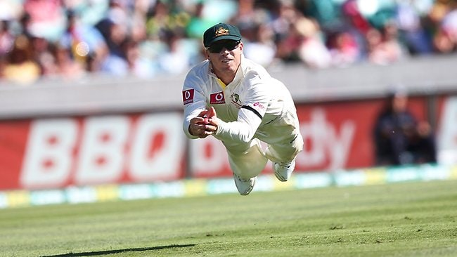 David Warner takes a sensational diving catch off Nathan Lyon to dismiss Lahiru Thirimanne for 91. Picture: Phil Hillyard