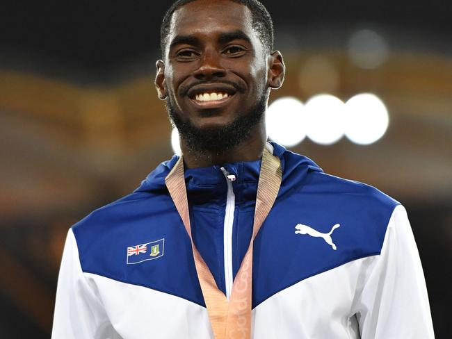 British Virgin Islands' Kyron Mcmaster (C gold) poses with his medals