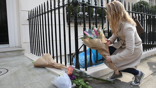 LONDON, ENGLAND - APRIL 08: A member of the public leaves a floral tribute outside the residence of Baroness Thatcher in Chester Square on April 8, 2013 in London, England. It has been confirmed that Lady Thatcher has died this morning following a stroke aged 87. Margaret Thatcher was the first female British Prime Minster and governed the UK from 1979 to 1990. She led the UK through some turbulent years and contentious issues including the Falklands War, the miner€s strike and the Poll Tax riots. (Photo by Peter Macdiarmid/Getty Images)